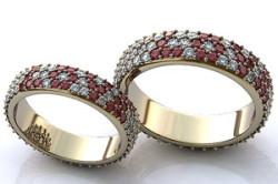 Серебряные обручальные кольца с россыпью мелких рубинов