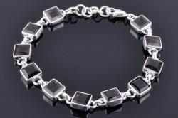 Серебряный браслет инструированный камнями