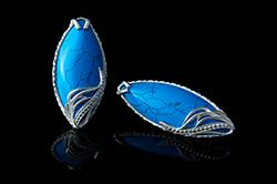 Серебряные серьги с бирюзой синего цвета.